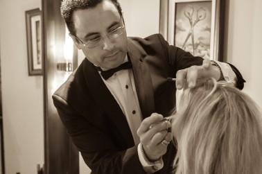 Robert Williams prepares make-up.