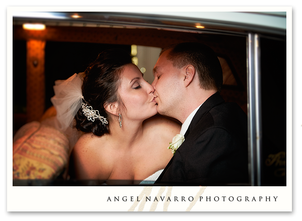 Bride and Groom Kissing in Limousine