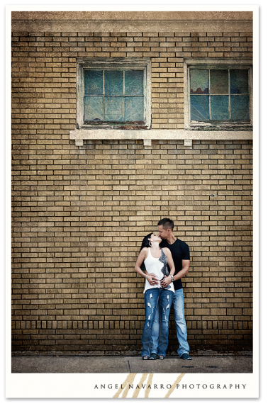 Tall building in background of couple's photo.