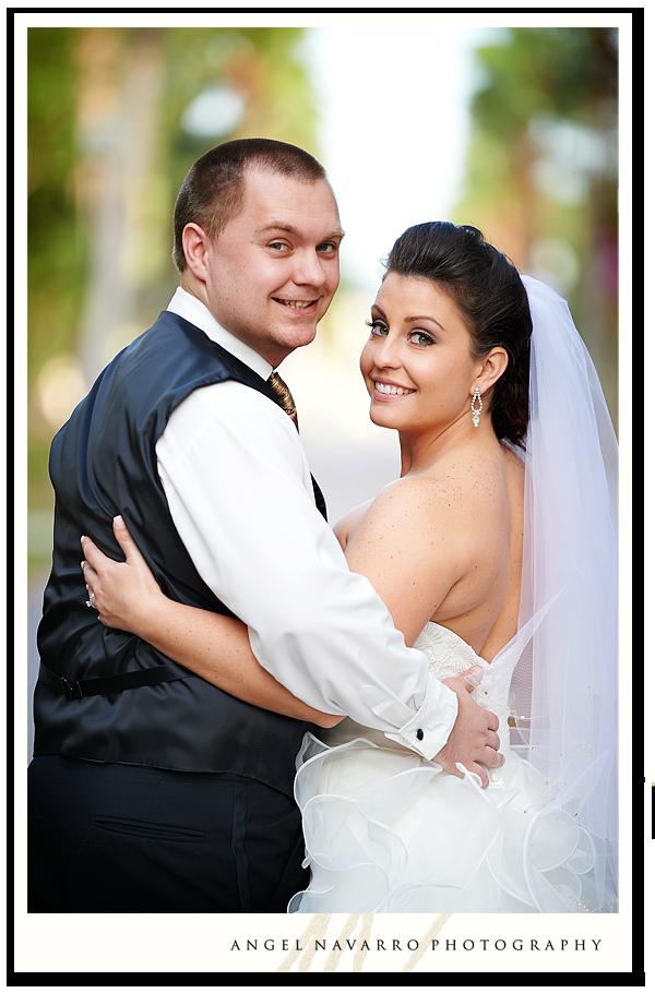 Bride and Groom Looking Ove their Shoulder
