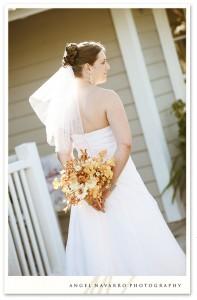 Bride holding bouquet behind her.