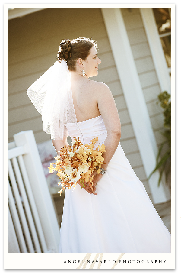 Bride holding bouquet behind her.