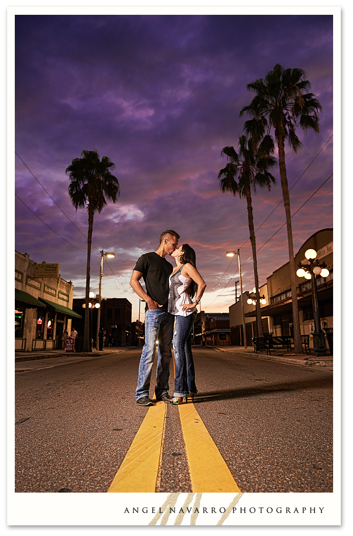 Amazing sky in this Ybor City photo of an engaged couple.