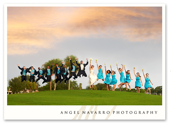 Bridal party jumps for a picture.