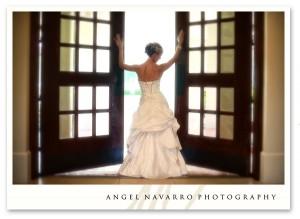 Bride parting double doors.