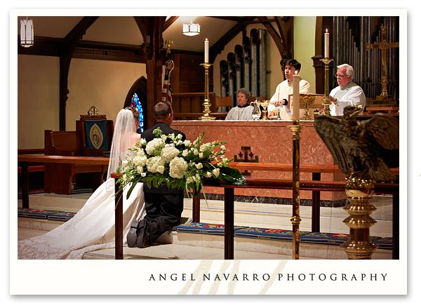 bride-groom-kneeling-altar-ceremony-tampa-photographer