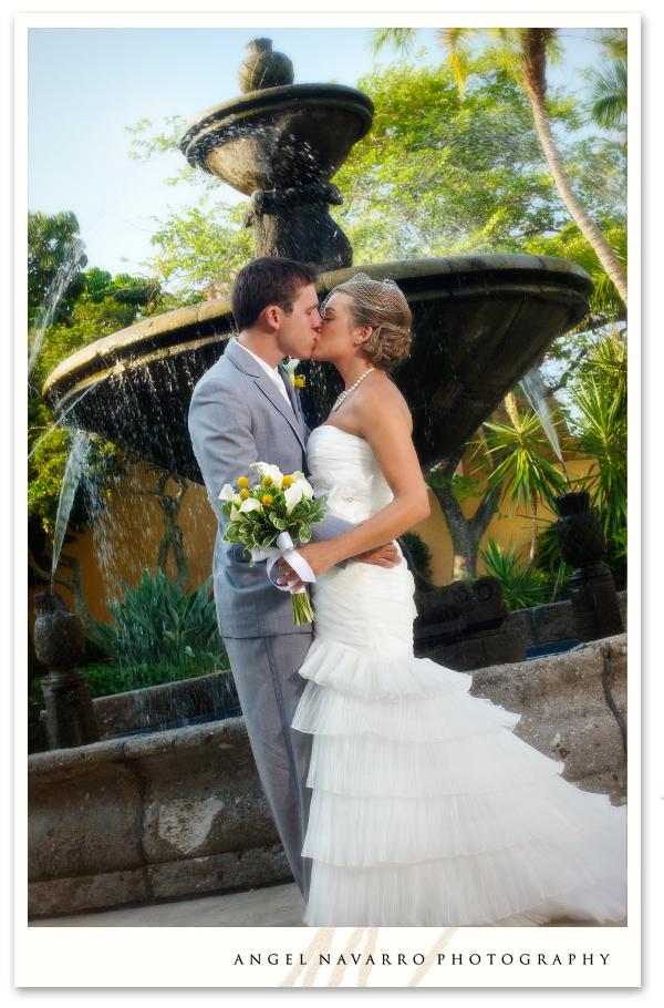 A wedding portrait by a fountain