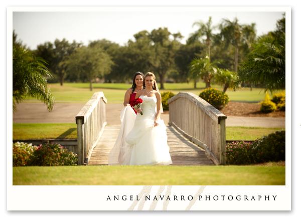 A beautiful bride steps over a bridge.