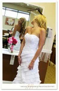 Bride looking over her gown