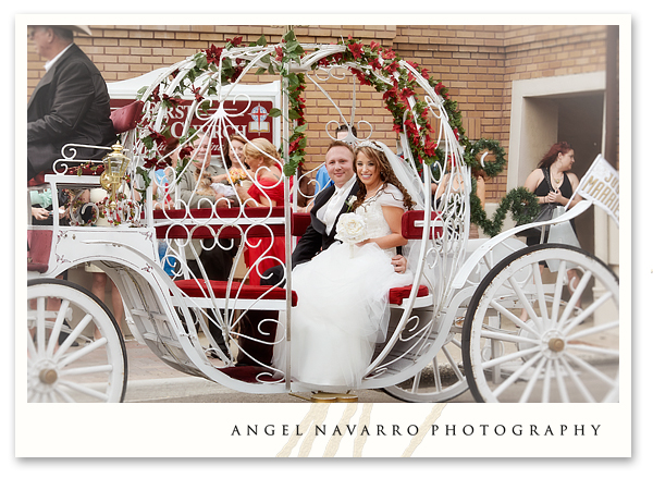 Wedding couple riding to the church on a horse-drawn carriage.