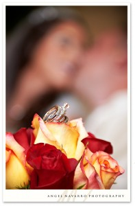 A creative picture of the wedding rings atop a wedding bouquet.