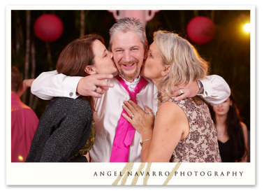 Father of the bride getting a double-kiss.