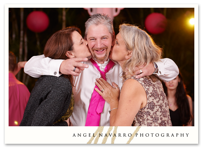 Father of the bride getting two kisses at the same time.