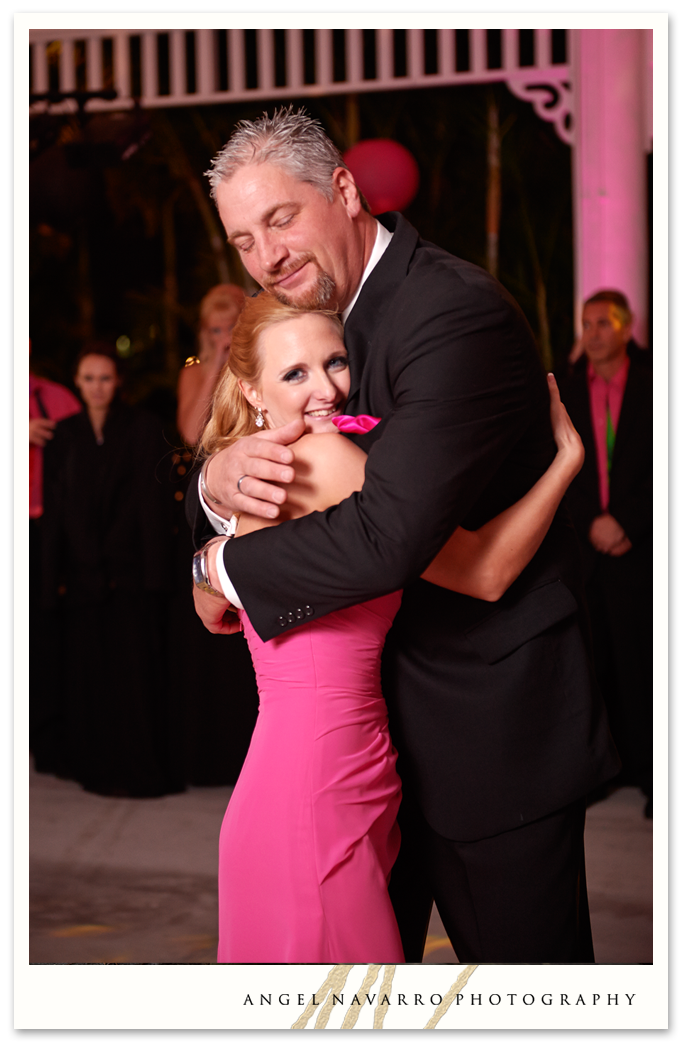 Father and daughter dance with embrace.