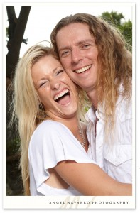 Engaged wedding couple laughing