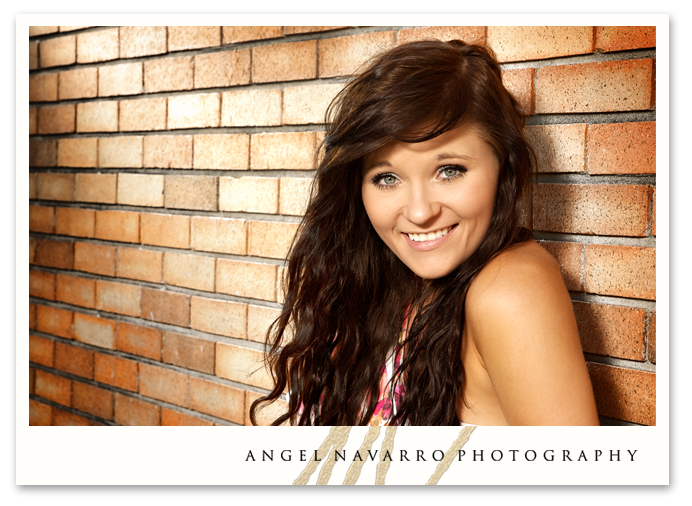 A gorgeous high school senior picture of a stylish gal.