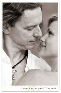 Stud-muffin groom kisses his fiancée.