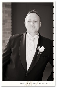 Photo of groom outdoors before the wedding ceremony.