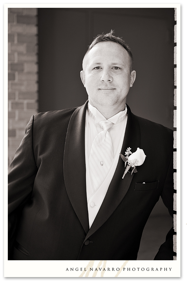 Outdoor photo of the groom in black and white.