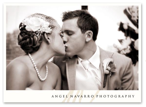 A kiss at the bridal table.