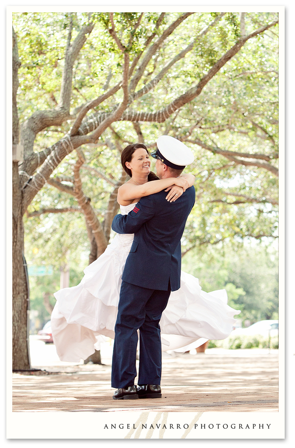 Military soldier spinning bride before wedding