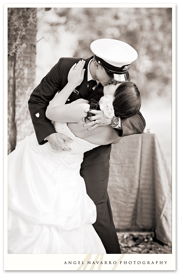 Military wedding soldier kissing bride