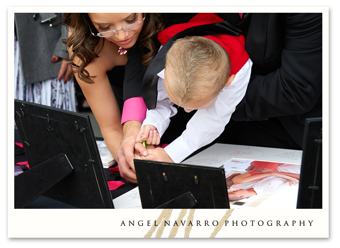 Ring bearer signs the engagement print.