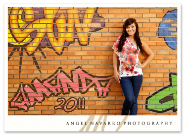 Senior portrait on graffiti wall.