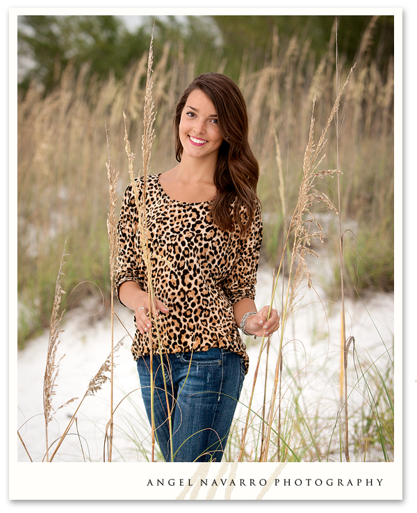High School Senior Photographed by Sea Oats at the Beach