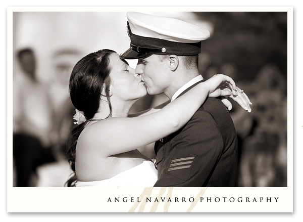 Soldier kissing bride reception dance