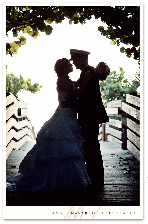 Soldier and bride outdoor kiss in silhouette
