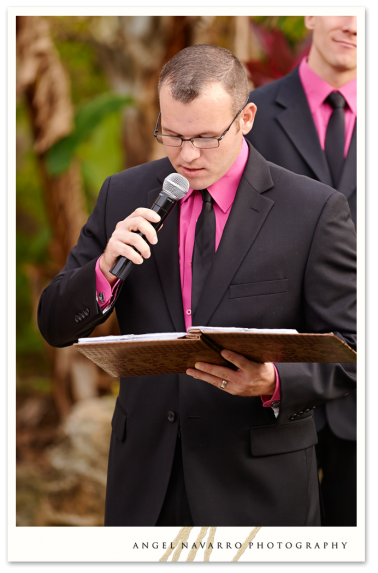 Groomsman reading during the wedding ceremony.