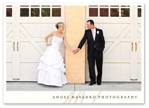 Bride and groom by garage doors