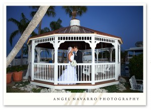 Bride and Groom Kissing in Gazebo at Night