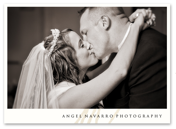 Bride and groom kiss during their first dance as husband and wife.