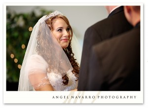 Bride filled with joy looks intently upon the groom.